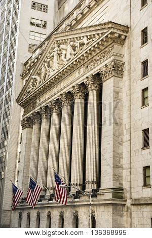 New York, USA - June 18, 2016: Vertical view of the New York Stock Exchange with American flags