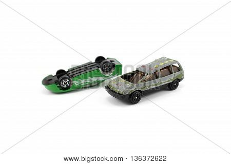two green car, dump and shocked isolated white background