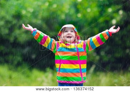Child Playing In The Rain