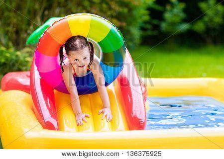 Little Girl In Garden Swimming Pool