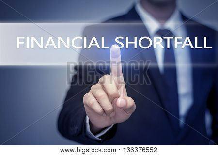 Businessman hand touching FINANCIAL SHORTFALL button on virtual screen