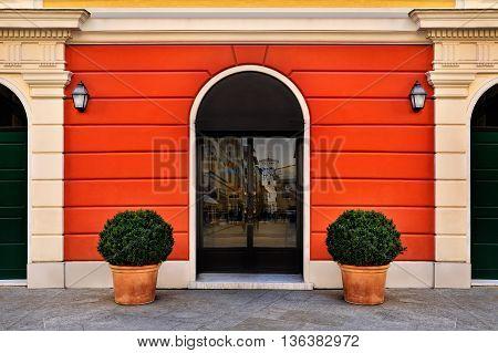 bright red symmetry facade with entrance door