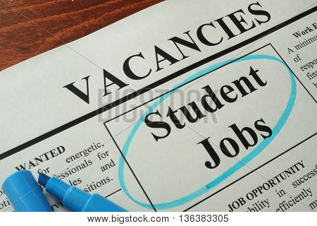 Newspaper with ads student jobs vacancy. Occupation concept.