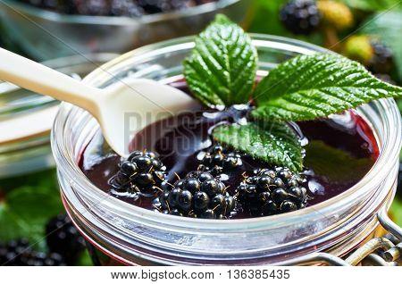 Jar with home made wild blackberry jam