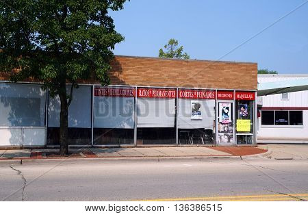 JOLIET, ILLINOIS / UNITED STATES - JUNE 30, 2015: One may have one's hair cut at Vicky's Unisex Salon in downtown Joliet.
