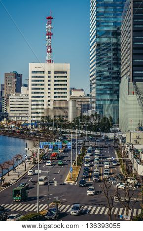 Tokyo Japan - February 27 2015. View of traffic and modern buildings at Uchibori-dori Street in Tokyo