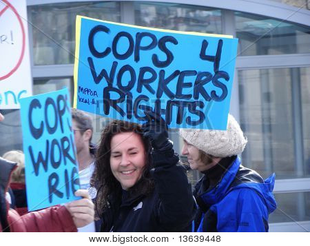 """Lady police office holding """"Cops 4 Workers Rights"""" sign"""