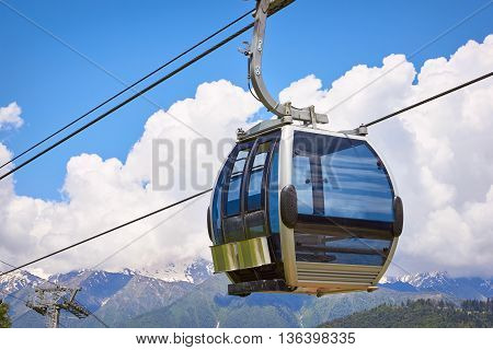 Cabin Of Ropeway In Mountains Among Clouds In The Sky