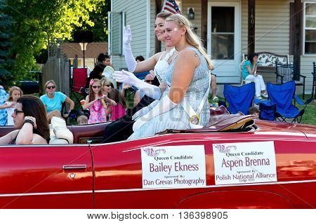 SOUTH ST. PAUL, MINNESOTA - JUNE 24, 2016: Kaposia Days Festival Queen Bailey Ekness (back) and Princess Aspen Brenna (front) wave to crowd in annual South St. Paul Grande Parade on June 24.
