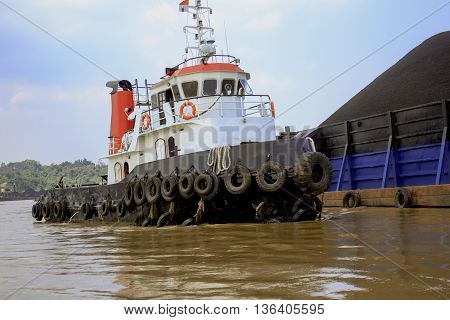 Small tug boat in mahakam river of indonesia