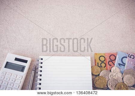 Australian money AUD with calculator notebook selective focus toning copy space background