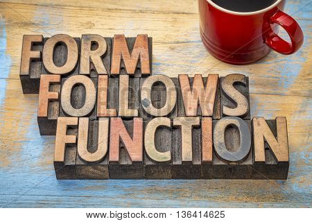 Form follows function - design concept - text in vintage letterpress wood type printing blocks with a cup of coffee