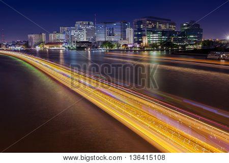 long exposure photography of siriraj hostipal and lighting of boat traffic in chaopraya river important landmark of bangkok thailand capital