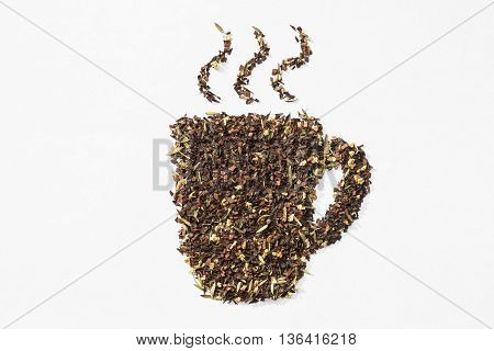 close up of loose honeybush tea teacup