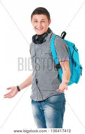 Full length portrait of a caucasian guy student of college or university with backpack. Young casual male presenting something on his face against white background.