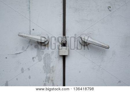Gray steel cabinet doors is lock it have gray color
