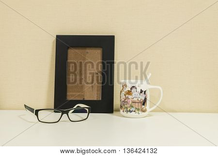 Frame for a photo with glasses and cute cup background