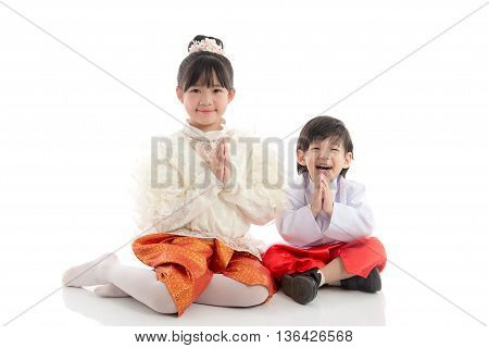 Asian children welcome expression Sawasdee on white backgroundisolated