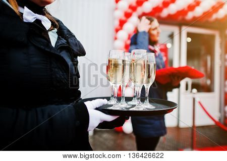 Waiter With A Tray Of Champagne Glasses At The Official Opening