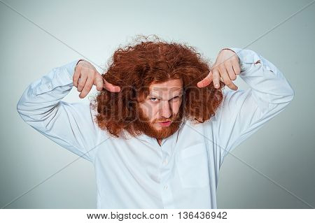 The young vexed man with long red hair