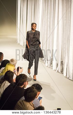 Johannesburg, South Africa - October 23, 2015: Model walking by runway. South African Fashion Week. Collection by ERRE. Catwalk. Hotel Crowne Plaza.