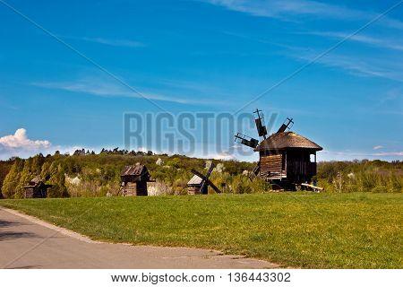 Landscape with old windmills in the village Pirogovo, Ukraine Eastern Europe.