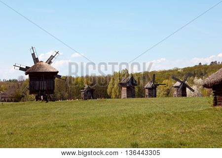 Landscape with old windmill in the village Pirogovo, Ukraine. Eastern Europe. Artistic retouching.