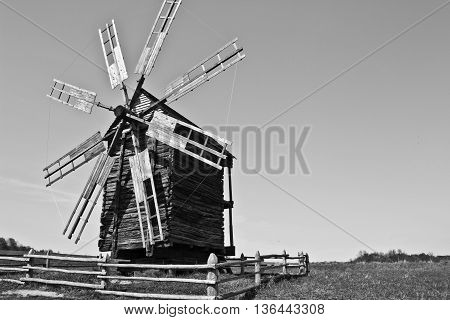 Landscape with old windmill in the village Pirogovo, Ukraine. Eastern Europe. Black and white image.