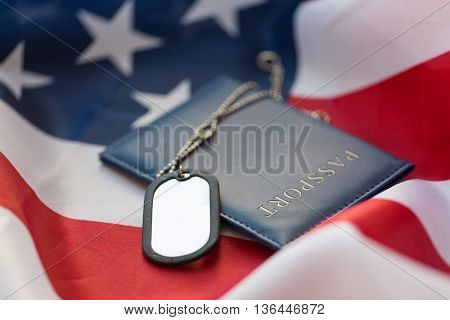 military forces, patriotism, recruitment and national service concept - close up of american flag, passport and military badge