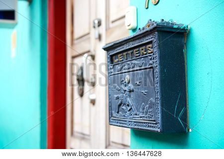 unique mail letter box against the wall