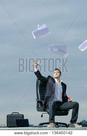 Businessman Throwing Paper Outdoor