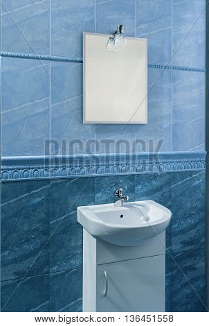 beautiful bathroom in blue with relief frieze