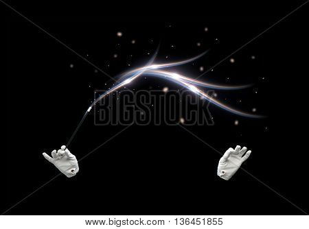 performance, illusion, circus, show concept - magician hands in gloves with illuminating magic wand showing trick over black background poster
