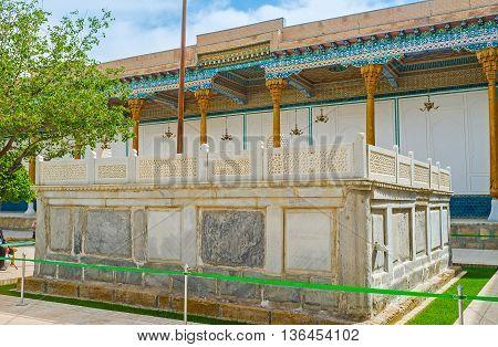 The stone sarcophagus of the Sheikh Naqshband the founder of the largest Sufi Muslim Order - Tariqa Naqshbandi Bukhara Uzbekistan. poster