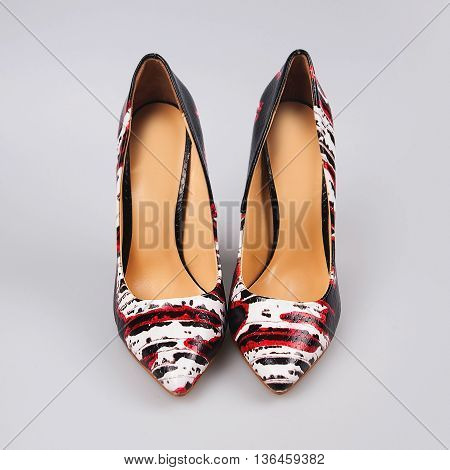 Female high heeled shoes in grey background