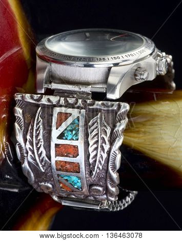Old Navajo silver watch cuff with turquoise and coral.