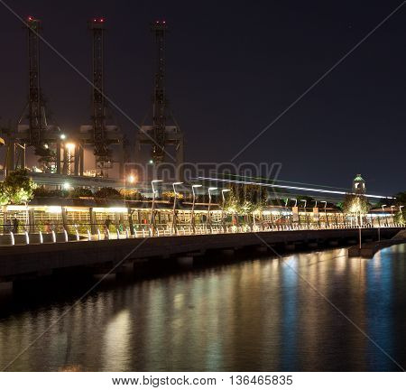 Singapore industrial port. And the way to sentosa at night. It is the world's busiest port in terms of total shipping tonnage it tranships a fifth of the world's shipping containers.