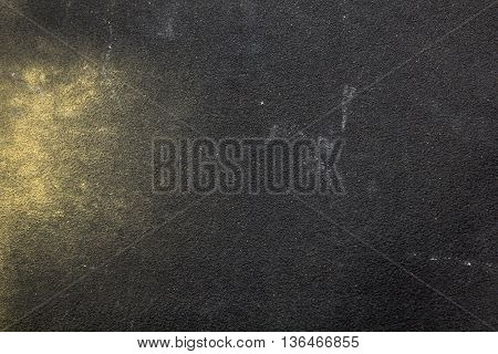 Grainy texture of sandpaper with wood shavings
