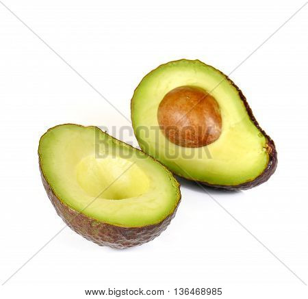 Avocado dark brown cut half isolated on white background.