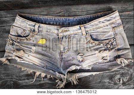 denim tore shorts with paste close up photo
