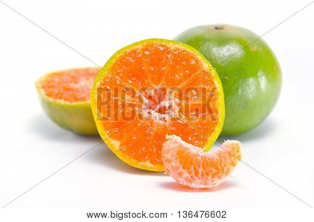 Orange fruit (Other names are Les Oranger sweet orange citrus sinensis Citrus aurantium Citrus maxima Citrus reticulate mandarin orange) with half view isolated on white background