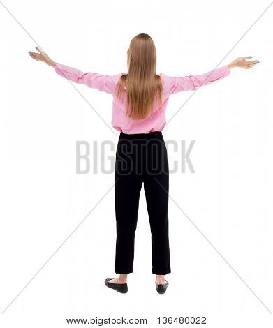 Back view of  business woman.  Raised his fist up in victory sign.    Raised his fist up in victory sign.   The girl office worker in black pants raised his hands to the sky.