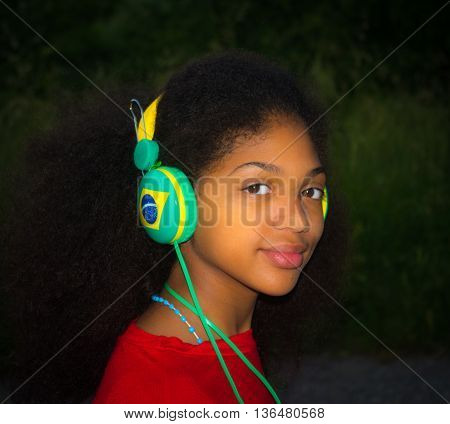 Brazilian girl with the happy brazil hat for the arrival of world sports festival the