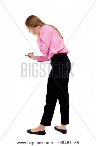 back view of writing beautiful woman. Rear view people collection.  backside view of person. Isolated over white background. Woman office worker in a pink shirt wrote marker.