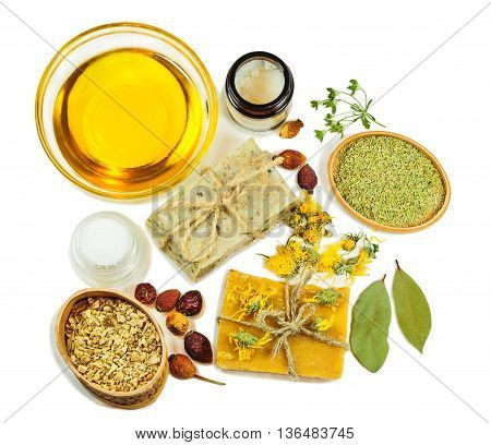 Top view of soap bars and soap making ingredients isolated on white background