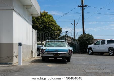 California USA - September 28 2015: 1957 Ford Thunderbird near the Food Mart of refueling station.