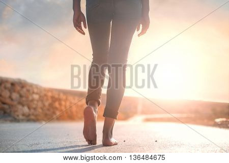 Walking down a sunny road