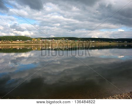 There are river, sky and cloudy sky