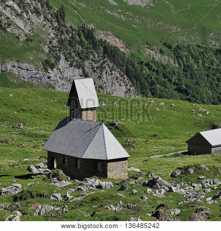 Old chapel high up on a mountain meadow in Appenzell Canton. Meglisalp.