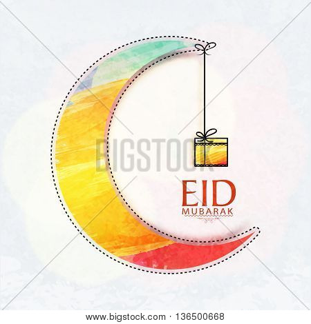 Elegant Greeting Card design with Colourful Big Crescent Moon and Hanging Gift for Islamic Holy Festival, Eid Mubarak celebration.